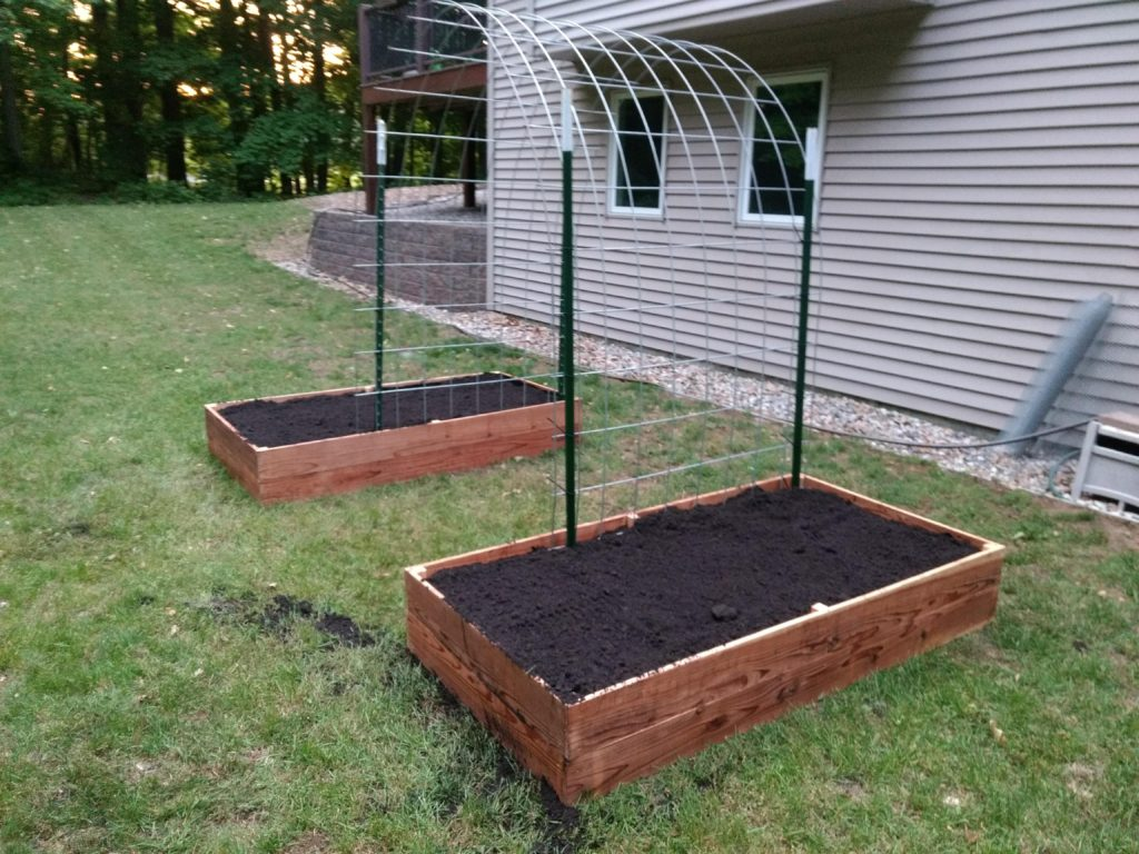 How to build 2 raised garden beds with an arched trellis - What to put under raised garden beds ...